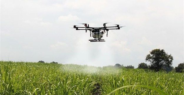 Agri Drone spraying in segmented part of a field